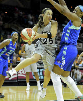 The Silver Stars' Becky Hammon (25) looks to make a pass around New York's Kia Vaughn (right) during a WNBA game between the San Antonio Silver Stars and the New York Liberty on Tuesday, Sept. 18, 2012, at the AT&T Center. Photo: John Albright, For The Express-News / San Antonio Express-News