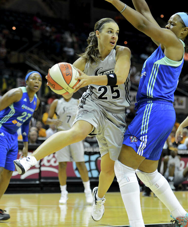 Guard Becky Hammon looks to pass around the New York Liberty's Kia Vaughn during Tuesday night's 77-66 Silver Stars victory at the AT&T Center. A 22-9 fourth quarter fueled the win. Photo: John Albright, For The Express-News / San Antonio Express-News