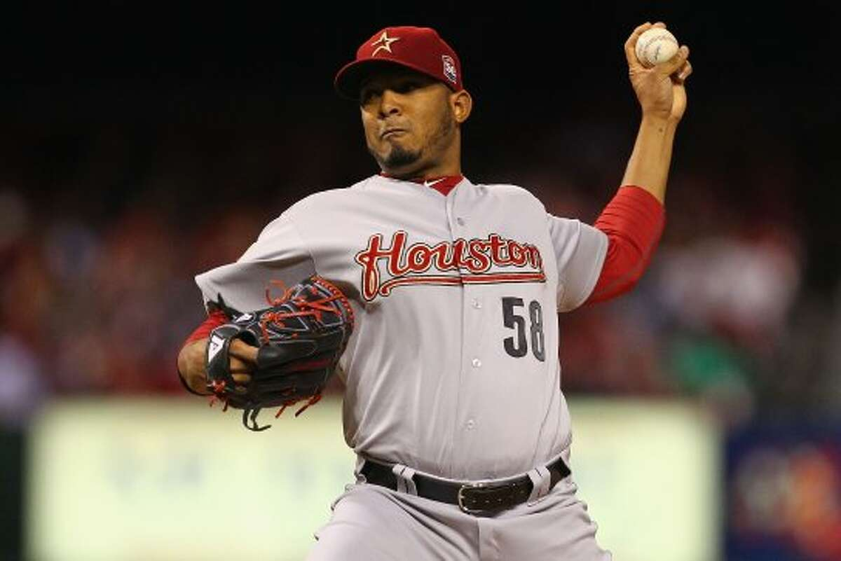 Astros' starter Fernando Abad delivers a throw against the Cardinals. (Dilip Vishwanat / 2012 Getty Images)