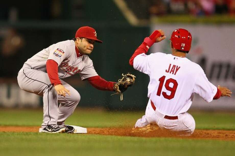 Jon Jay of the Cardinals is caught stealing at second base by Jose Altuve. (Dilip Vishwanat / 2012 Getty Images)