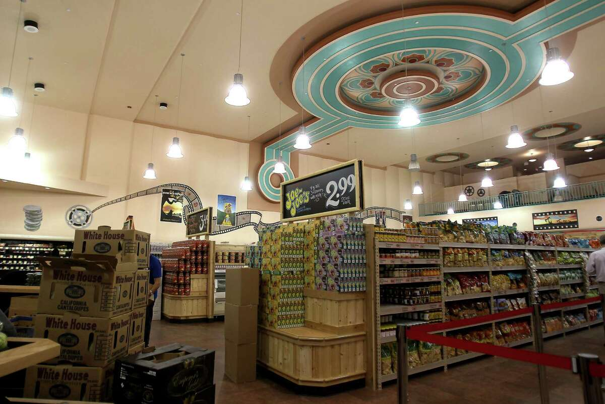 The art deco ceiling medallion restored to its original state looms over the new Trader Joe's in the Alabama Theater on Shepherd.