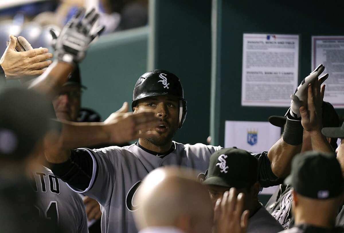 KANSAS CITY, MO - SEPTEMBER 18: Alex Rios #51 of the Chicago White Sox celebrates his home run with teammates during a game against the Kansas City Royals in the seventh inning at Kauffman Stadium on September 18, 2012 in Kansas City, Missouri. (Photo by Ed Zurga/Getty Images)