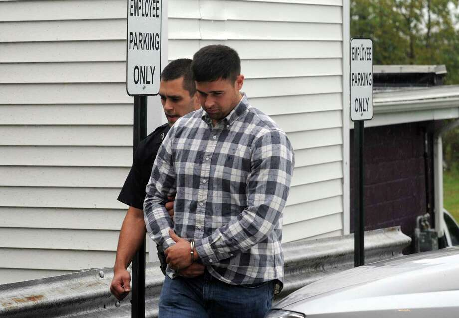 Jeff Lukens Jr. is led into  Coeymans Town Court in Ravena, NY Tuesday Sept. 18, 2012. (Michael P. Farrell/Times Union) Photo: Michael P. Farrell