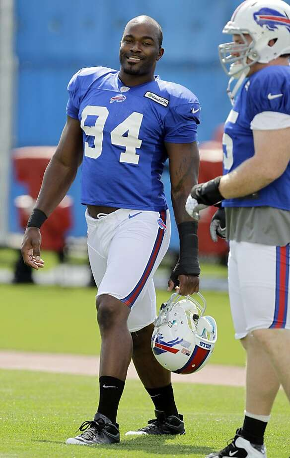 Buffalo Bills' Mario Williams (94) talks with teammate Kyle Williams (95) during NFL football practice in Orchard Park, N.Y., Wednesday, Sept. 5, 2012. (AP Photo/David Duprey) Photo: David Duprey, Associated Press