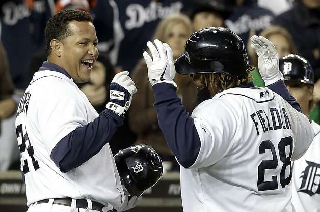 Prince Fielder (right) celebrates his homer with Miguel Cabrera, who hit a pair. Photo: Paul Sancya, Associated Press