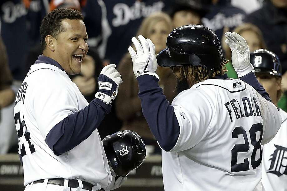 Detroit Tigers' Prince Fielder (28) celebrates his two-run home run against the Oakland Athletics with Miguel Cabrera, left, in the fifth inning of a baseball game in Detroit on Tuesday, Sept. 18, 2012. (AP Photo/Paul Sancya) Photo: Paul Sancya, Associated Press