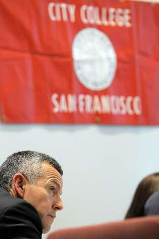 City College of San Francisco board member Rodrigo Santos listens to the state analysts' findings on the school. Photo: Carlos Avila Gonzalez - San Fran, The Chronicle
