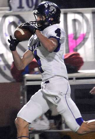 "PNG's Jayce Nelson makes the catch during the first half of the play off game at the Carrol A. ""Butch"" Thomas Educational Support Center in Beaumont, Saturday. Tammy McKinley/The Enterprise Photo: TAMMY MCKINLEY / Beaumont"