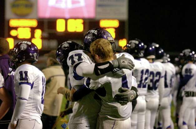 PN-G football players Trey Hollier, left, and Jayce Nelson console each other in the final moments of the Indians playoff loss to the Manvel Mustangs at Stallworth Stadium, Baytown Texas. Saturday, November 27, 2010.  Valentino Mauricio/The Enterprise Photo: Valentino Mauricio / Beaumont