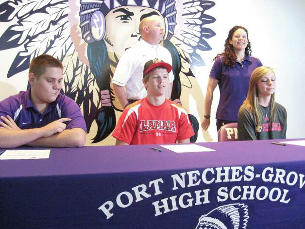 Signing for Port Neches-Groves on Wednesday were football players Kyler Nicotre (offensive line, Missouri Valley College), Jayce Nelson (receiver, Lamar) and softball player Brittnee Moore (pitcher, Jones College). Photo by David Henry/The Enterprise. Photo: David Henry