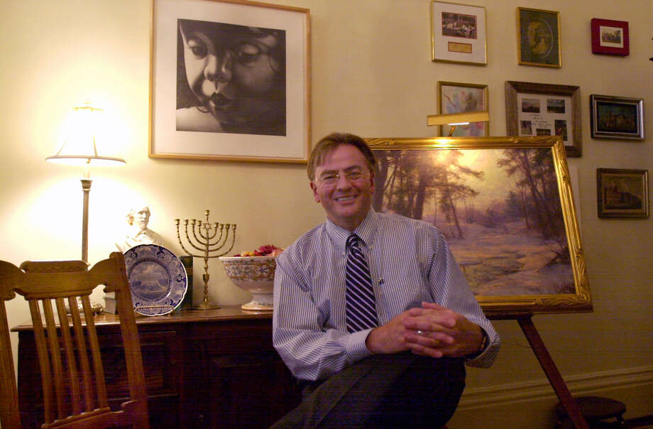 "Times Union staff photo by Angela Bishop   Richard Enemark sits in his office at the Doane Stuart School on Wednesday, June 7, 2004, in Albany, N.Y.  Above his head to his right was a picture painted by his wife, to his left was a painting by Walter Launt Palmer, ""Winter Brook"", and to his bottom right was a chair from the Mohonk Mountain House. Photo: ANGELA BISHOP / TIMES UNION"