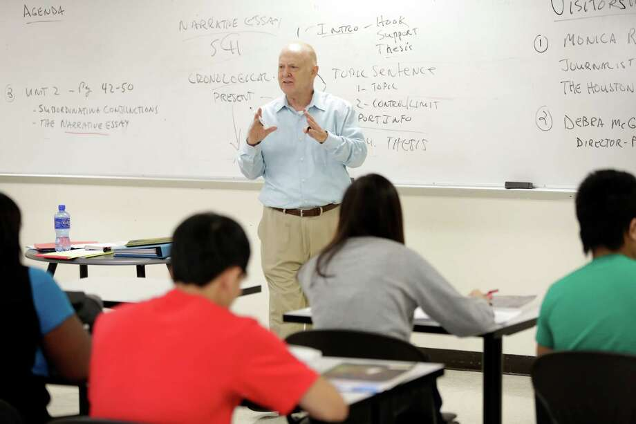 English professor Philip Hardy gives a lesson, during an intensive English class, Thursday, September 13, 2012 at Houston Community College main campus in Houston, Texas. (TODD SPOTH FOR THE CHRONICLE) Photo: TODD SPOTH / © TODD SPOTH, 2012