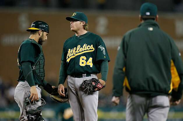 A.J. Griffin (center) and catcher George Kottaras wait for manager Bob Melvin in the fifth inning. It was Griffin's first loss, and worst outing, of his previously charmed rookie season. Photo: Gregory Shamus, Getty Images