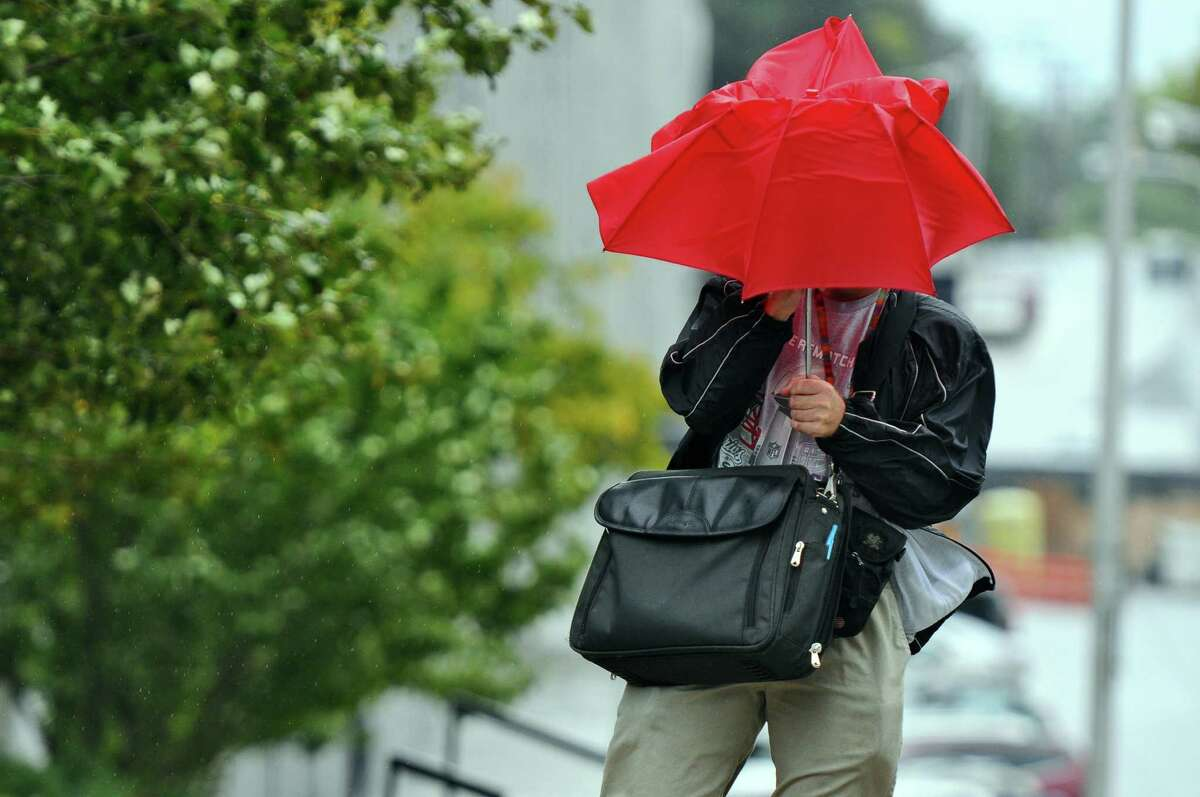 Mike Cohen of Albany struggles to stay dry as he and his umbrella do battle with the wind and the rain, as he heads between buildings for work on South Swan Street at the intersection of State Street on Tuesday Sept. 18, 2012 in Albany, NY. (Philip Kamrass / Times Union)