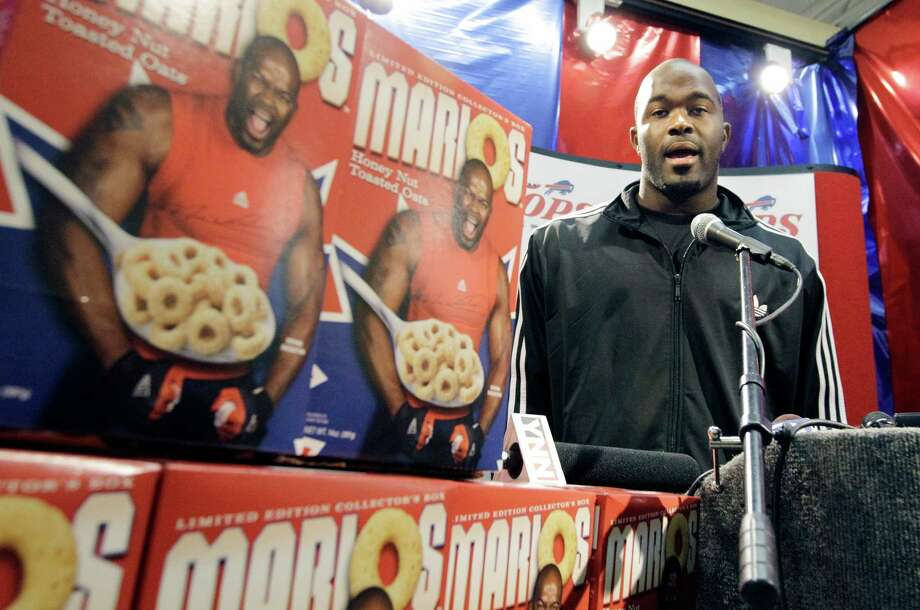 Buffalo Bills' Mario Williams, an NFL football player, introduces his new cereal during a news conference in West Seneca, N.Y., Tuesday, Sept. 18, 2012. (AP Photo/David Duprey) Photo: David Duprey