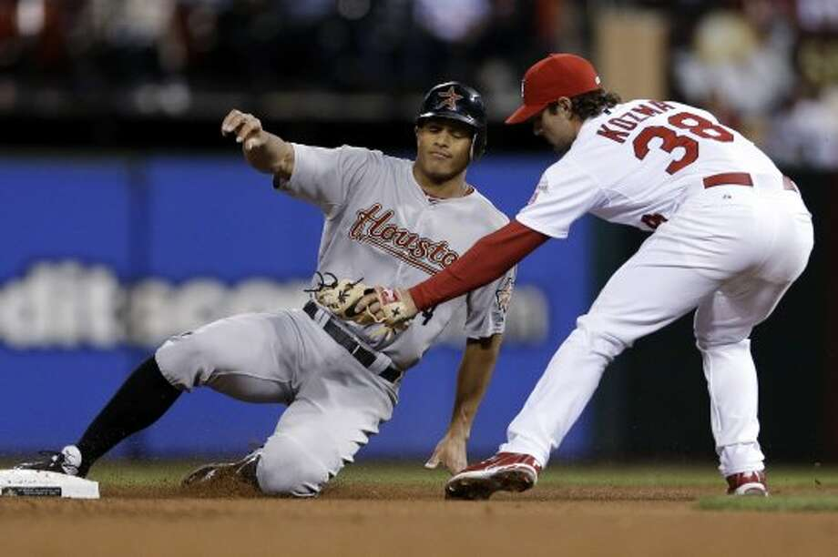 Justin Maxwell is tagged out by Cardinals' shortstop Pete Kozma while trying to steal second during the fourth inning. (Jeff Roberson / Associated Press)