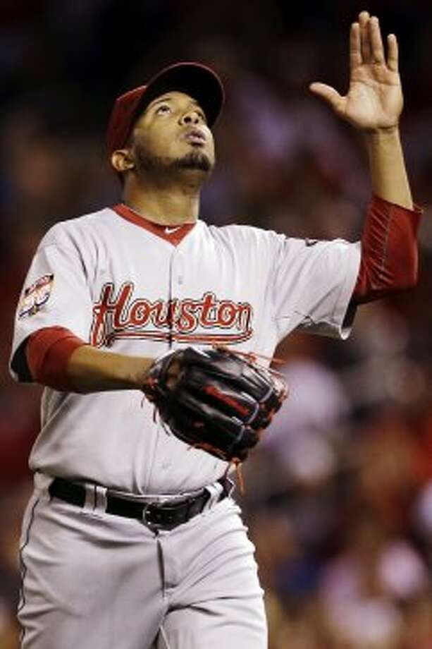 Fernando Abad looks skyward as he walks off the field after striking out St. Louis Cardinals' Matt Holliday to end the third inning. of a baseball game, Tuesday, Sept. 18, 2012, in St. Louis. (AP Photo/Jeff Roberson) (Jeff Roberson / Associated Press)