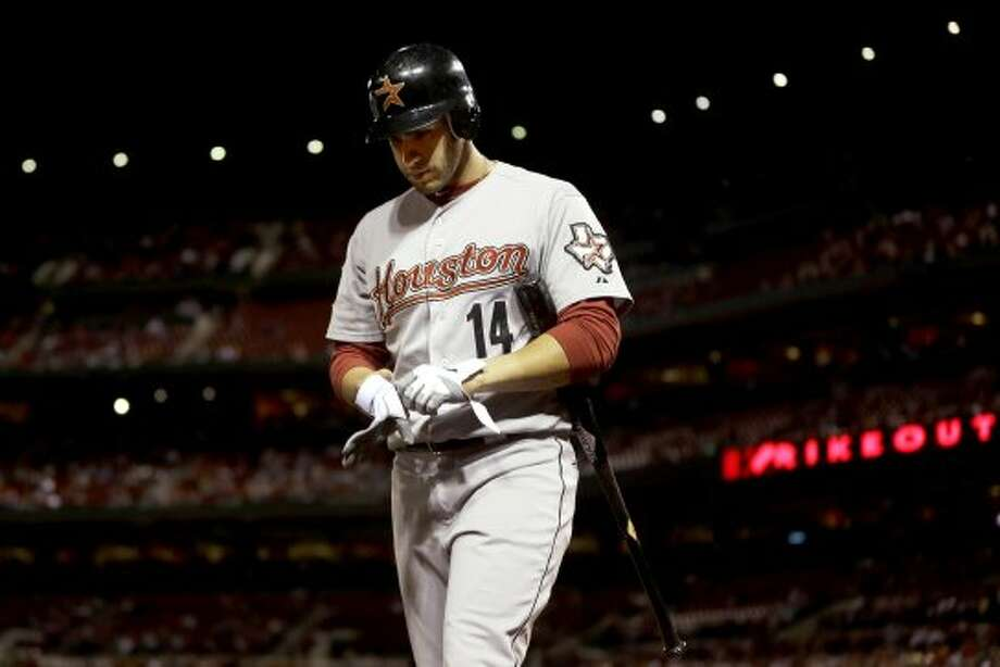 J.D. Martinez walks off the field after striking out during the second inning. (Jeff Roberson / Associated Press)