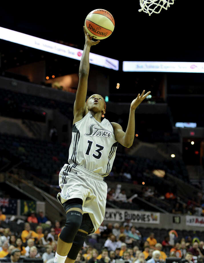 The Silver Stars' Danielle Robinson (13) takes an uncontested lay-up on a fast break during a WNBA game between the San Antonio Silver Stars and the New York Liberty on Tuesday, Sept. 18, 2012, at the AT&T Center. Photo: John Albright, For The Express-News / San Antonio Express-News