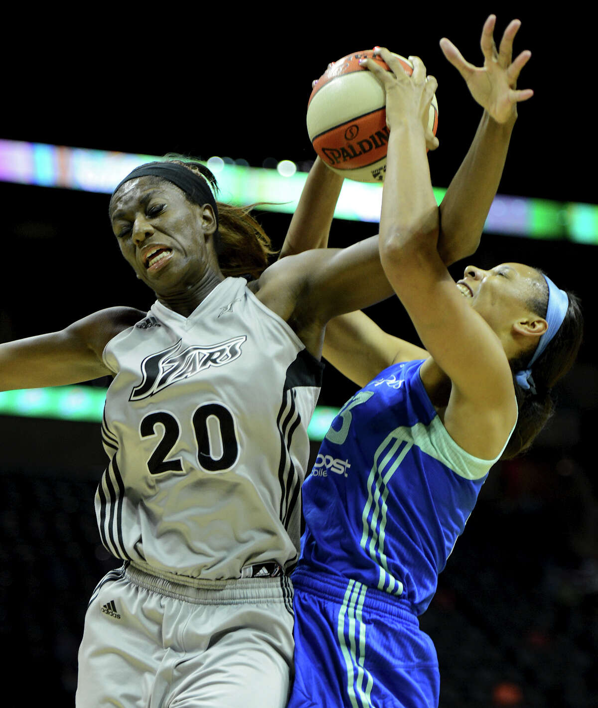 The Silver Stars' Shameka Christon (20) gets tangled up with New York's Plenette Pierson (right) while trying to collect a rebound during a WNBA game between the San Antonio Silver Stars and the New York Liberty on Tuesday, Sept. 18, 2012, at the AT&T Center.