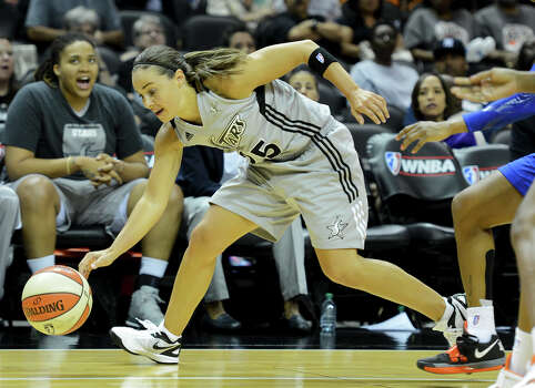 The Silver Stars' Becky Hammon chases down a loose ball during a WNBA game between the San Antonio Silver Stars and the New York Liberty on Tuesday, Sept. 18, 2012, at the AT&T Center. Photo: John Albright, For The Express-News / San Antonio Express-News