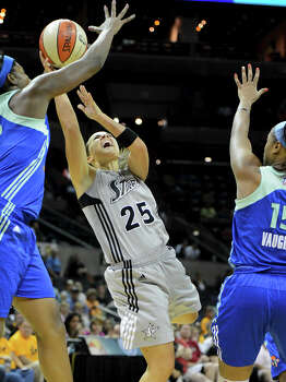 The Silver Stars' Becky Hammon (25) is fouled as she takes a shot during a WNBA game between the San Antonio Silver Stars and the New York Liberty on Tuesday, Sept. 18, 2012, at the AT&T Center. Photo: John Albright, For The Express-News / San Antonio Express-News