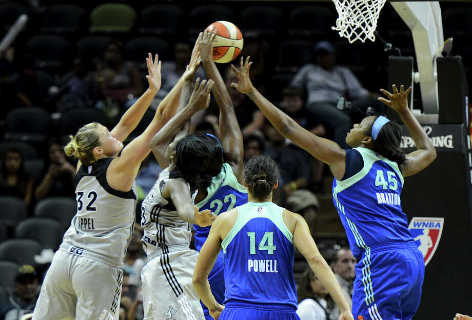 The San Antonio Silver Stars and the New York Liberty players battle for a rebound during a WNBA game on Tuesday, Sept. 18, 2012, at the AT&T Center. Photo: John Albright, For The Express-News / San Antonio Express-News