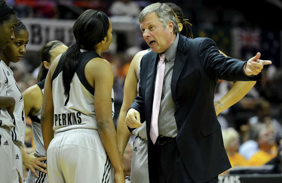 Silver Stars' head coach Dan Hughes (right) talks with Jia Perkins during a time-out during a WNBA game between the San Antonio Silver Stars and the New York Liberty on Tuesday, Sept. 18, 2012, at the AT&T Center. Photo: John Albright, For The Express-News / San Antonio Express-News