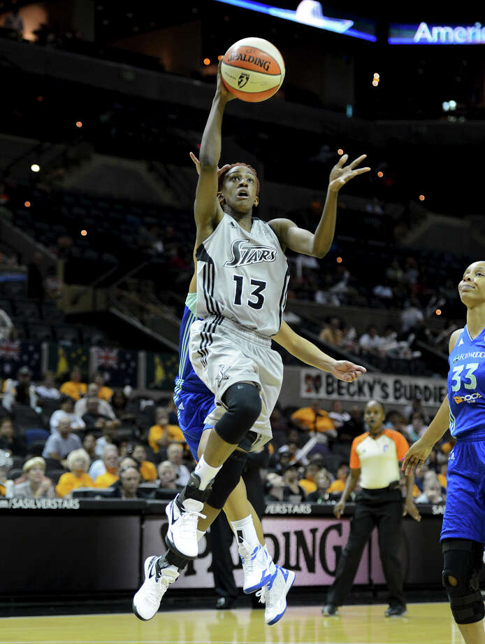 The Silver Stars' Danielle Robinson (13) takes a shot during a WNBA game between the San Antonio Silver Stars and the New York Liberty on Tuesday, Sept. 18, 2012, at the AT&T Center. Photo: John Albright, For The Express-News / San Antonio Express-News