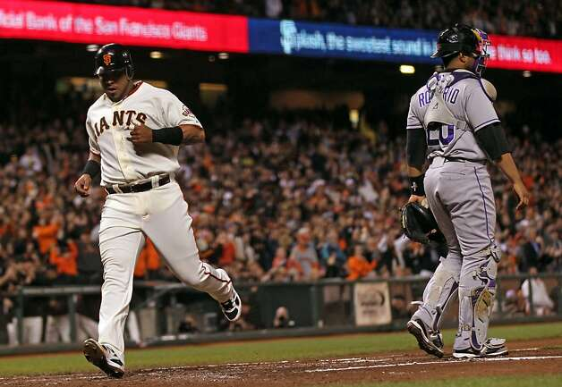San Francisco Giants Hector Sanchez scores off a base hit by Xavier Nady in the second inning of their MLB baseball game against the Colorado Rockies  Tuesday September 18, 2012 in San Francisco California. Photo: Lance Iversen, The Chronicle