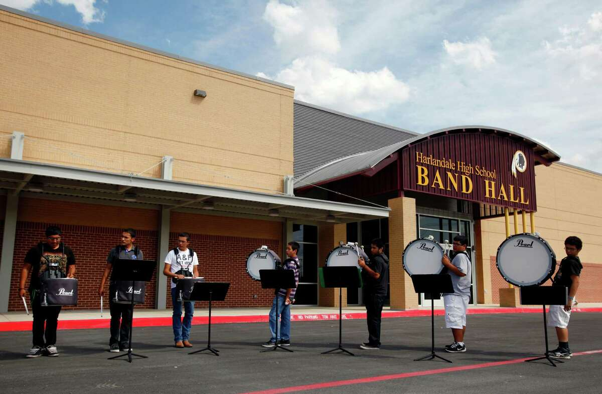 Members of the marching band drumline practice Tuesday Sept. 18, 2012 iin front of the bond-funded and recently-finished Harlandale High School band hall. The facility, along with a new field house and a new band hall and field house at McCullom High School, are the first new such facilities built in the district in 50 years.