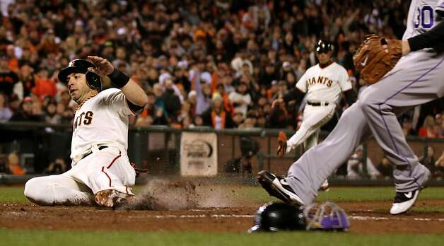 San Francisco Giants Marco Scutaro scores on a wild pitch in the 7th inning against the Colorado Rockies Tuesday September 18, 2012 in San Francisco California. Photo: Lance Iversen, The Chronicle
