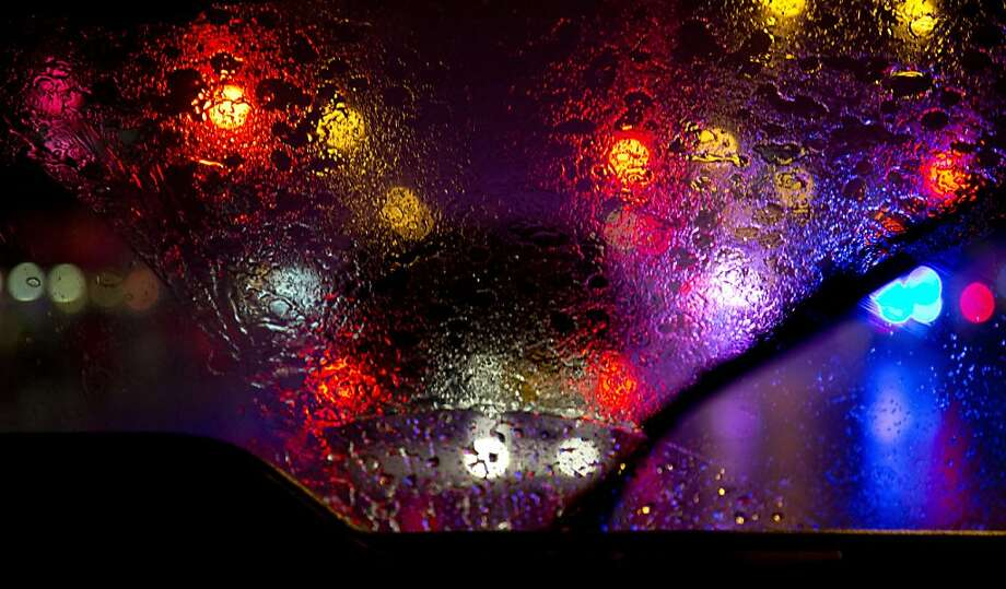 Windshield wipers of the media van have trouble keeping up with the pouring rain as the motorcade with President Barack Obama aboard moves to a campaign event, Tuesday, Sept. 18, 2012, in New York. Photo: Carolyn Kaster, Associated Press
