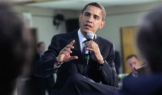 Democratic presidential hopeful Sen. Barack Obama, D-Ill., talks with veterans gathered for a town hall meeting-style campaign event at the American Legion Post 490 Friday, Feb. 29, 2008, in Houston, Texas. Photo: Rick Bowmer, AP / AP