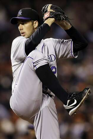 Colorado Rockies starting pitcher Jeff Francis throws to the San Francisco Giants during the first inning of a baseball game, Tuesday, Sept. 18, 2012, in San Francisco. (AP Photo/Marcio Jose Sanchez) Photo: Marcio Jose Sanchez, Associated Press