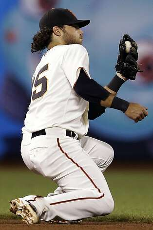 San Francisco Giants shortstop Brandon Crawford stops a ground ball from Colorado Rockies' Chris Nelson during the fourth inning of a baseball game, Tuesday, Sept. 18, 2012, in San Francisco. Crawford threw out Nelson at first base on the play. (AP Photo/Marcio Jose Sanchez) Photo: Marcio Jose Sanchez, Associated Press