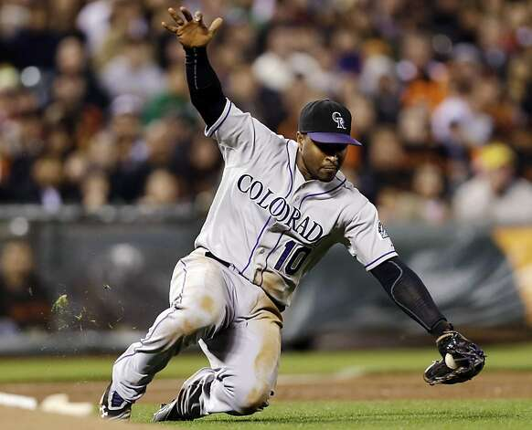 Colorado Rockies third baseman Chris Nelson makes a sliding play on a ground ball from San Francisco Giants' Tim Lincecum during the fourth inning of a baseball game, Tuesday, Sept. 18, 2012, in San Francisco. Nelson threw out Lincecum at first base. (AP Photo/Marcio Jose Sanchez) Photo: Marcio Jose Sanchez, Associated Press