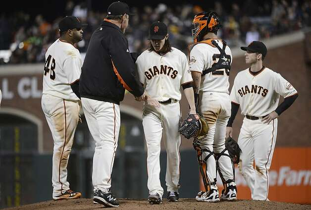 SAN FRANCISCO, CA - SEPTEMBER 18:  Manager Bruce Bochy #15 of the San Francisco Giants takes the ball from pitcher Tim Lincecum #55 taking him out of the game while teammates Pablo Sandoval #48, Hector Sanchez #29, and Buster Posey #28 looks on in the seventh inning against the Colorado Rockies at AT&T Park on September 18, 2012 in San Francisco, California.  (Photo by Thearon W. Henderson/Getty Images) Photo: Thearon W. Henderson, Getty Images