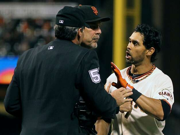 "San Francisco Giants Manager Bruce Bochy steps ""between"" home plate umpire Angel Hernandez and Angel Pagan after Pagan was fined throwing his bat, after being called out on strikes by Hernandez in the sixth inning. The Giants lead the Colorado Rockies 3-0 in the 7th inning Tuesday September 18, 2012 in San Francisco California. Photo: Lance Iversen, The Chronicle"