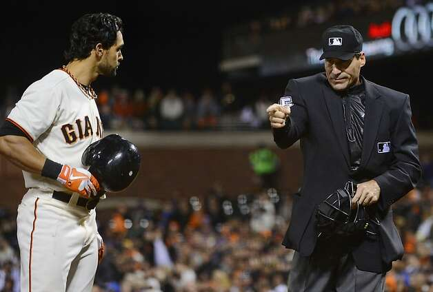 SAN FRANCISCO, CA - SEPTEMBER 18:  Home Plate umpire Angel Hernandez #55 points at Angel Pagan #16 of the San Francisco Giants after Pagan react to stiking out by throwing his bat in the air during the six inning against the Colorado Rockies at AT&T Park on September 18, 2012 in San Francisco, California.  (Photo by Thearon W. Henderson/Getty Images) Photo: Thearon W. Henderson, Getty Images