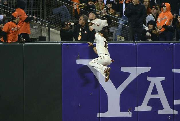 SAN FRANCISCO, CA - SEPTEMBER 18:  Angel Pagan #16 of the San Francisco Gaints leaps but watches the ball go over the fence for a two-run home run off the bat of Wilin Rosario #20 of the Colorado Rockies (not pictured) in the eighth inning at AT&T Park on September 18, 2012 in San Francisco, California.  (Photo by Thearon W. Henderson/Getty Images) Photo: Thearon W. Henderson, Getty Images