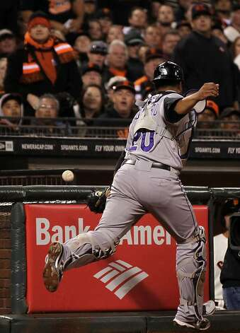 Colorado Rockies catcher Wilin Rosario can't reach San Francisco Giants Brandon Crawford foul ball in the 4th inning of their MLB baseball game Tuesday September 18, 2012 in San Francisco California. Photo: Lance Iversen, The Chronicle