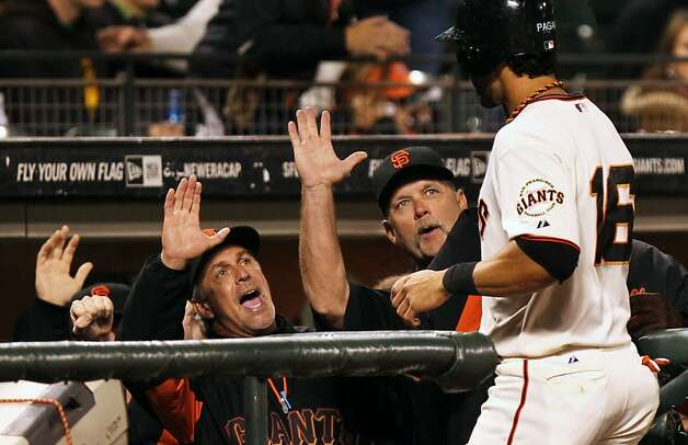 The Giants' dugout welcomes Angel Pagan after he scored in the eighth inning. Photo: Lance Iversen, The Chronicle
