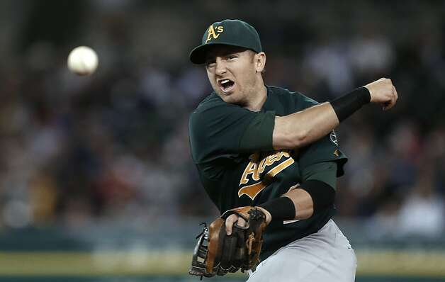 Oakland Athletics second baseman Cliff Pennington throws to first base for the out on Detroit Tigers' Quintin Berry during the third inning of a baseball game in Detroit on Tuesday, Sept. 18, 2012. (AP Photo/Paul Sancya) Photo: Paul Sancya, Associated Press