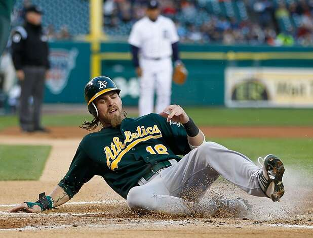 DETROIT, MI - SEPTEMBER 18: Josh Reddick #16 of the Oakland Athletics slides across home plate to score a first inning run while playing the Detroit Tigers at Comerica Park on September 18, 2012 in Detroit, Michigan.  (Photo by Gregory Shamus/Getty Images) Photo: Gregory Shamus, Getty Images