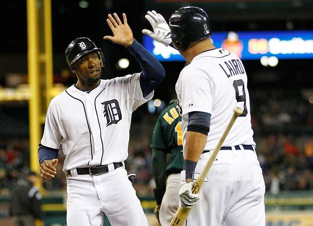 DETROIT, MI - SEPTEMBER 18: Austin Jackson #14 of the Detroit Tigers celebrates scoring a sixth inning run with Gerald Laird #9 while playing the Oakland Athletics at Comerica Park on September 18, 2012 in Detroit, Michigan.  (Photo by Gregory Shamus/Getty Images) Photo: Gregory Shamus, Getty Images