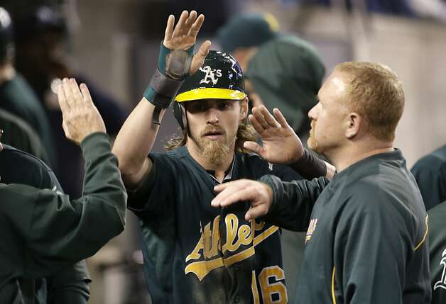 Oakland Athletics' Josh Reddick celebrates scoring on a Yoenis Cespedes hit in the seventh inning of a baseball game against the Detroit Tigers in Detroit on Tuesday, Sept. 18, 2012. (AP Photo/Paul Sancya) Photo: Paul Sancya, Associated Press