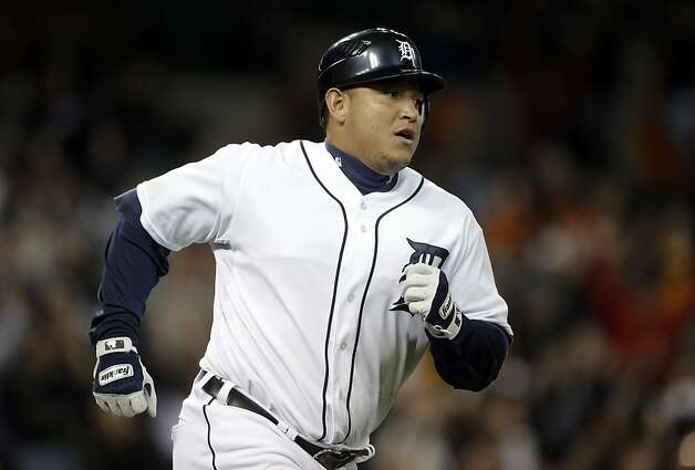 Detroit Tigers' Miguel Cabrera runs the bases after hitting a grand slam against the Oakland Athletics in the eighth inning of a baseball game in Detroit on Tuesday, Sept. 18, 2012. (AP Photo/Paul Sancya) Photo: Paul Sancya, Associated Press