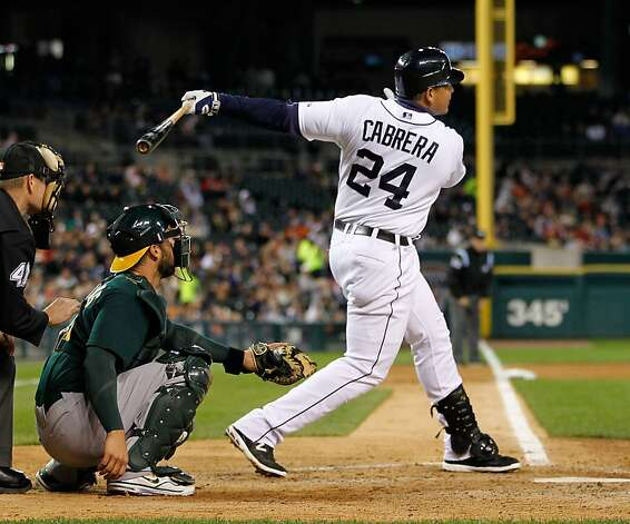 DETROIT, MI - SEPTEMBER 18: Miguel Cabrera #24 of the Detroit Tigers hits a fifth inning double in front of George Kottaras #14 of the Oakland Athletics at Comerica Park on September 18, 2012 in Detroit, Michigan. Detroit won the game 12-2.  (Photo by Gregory Shamus/Getty Images) Photo: Gregory Shamus, Getty Images