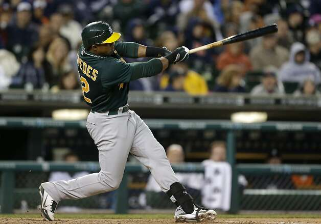 Oakland Athletics' Yoenis Cespedes hits a RBI single against the Detroit Tigers in the seventh inning of a baseball game in Detroit Tuesday, Sept. 18, 2012.  (AP Photo/Paul Sancya) Photo: Paul Sancya, Associated Press
